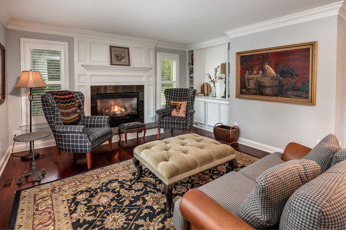 Cozy sitting room with gas Fireplace adjacent to kitchen